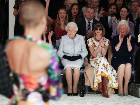 fashion design contest london queen elizabeth ii sits next to anna wintour at london