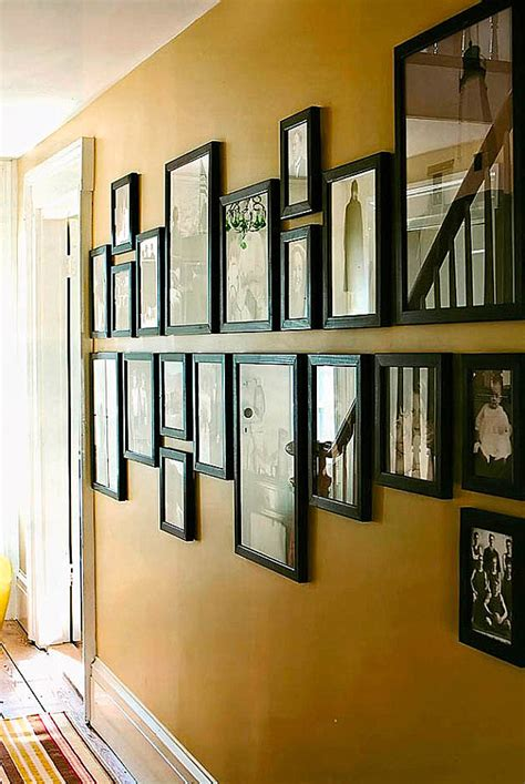 ideas on hanging pictures in hallway helpful hints for displaying family photos on your walls