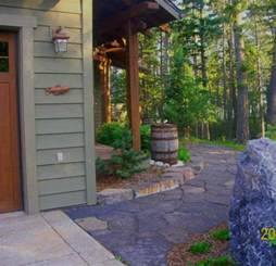 beautiful flagstone pathway wraps around the front of the house to the front door rustic look