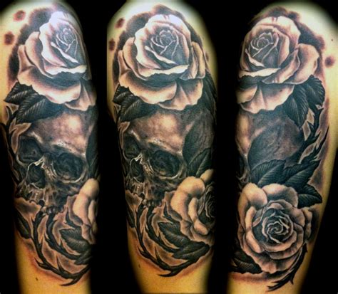 black rose tattoo arm black and grey ink skull and on sleeve