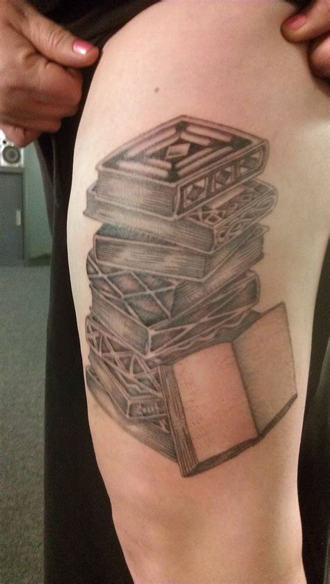 beautiful tattoo of black books tattoomagz