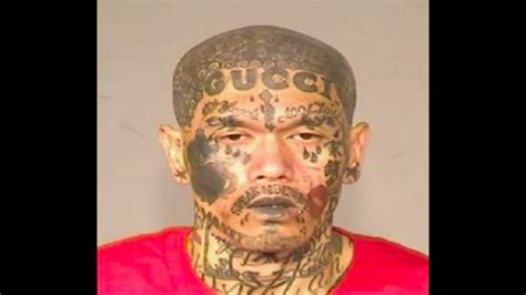 police man with gucci face tattoo arrested for weapons