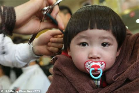 chinese haircuts games for kids children undergo traditional lucky haircuts in china