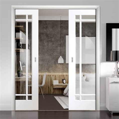 cheshire white double evokit pocket doors clear glass