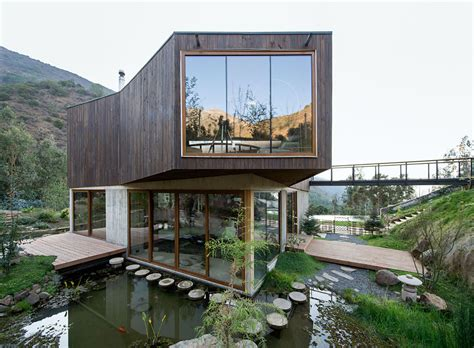 sustainable homes casa el maqui in chile is surrounded by flooded gardens
