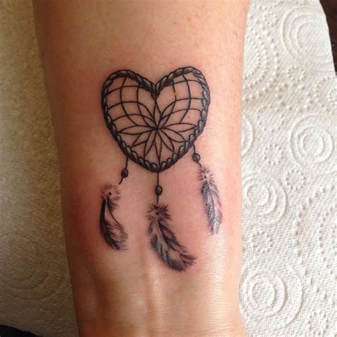 heart feather tattoo designs 30 wrist tattoos designs ideas design trends