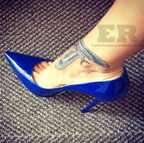 rihanna leg tattoo rihanna gets falcon ankle entertainment rundown