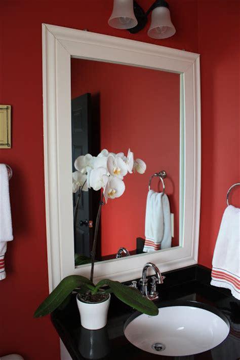 framing a builder grade bathroom mirror the yellow cape cod builder grade bathroom gets a custom look