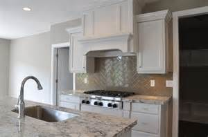 white and gray kitchen features crisp white cabinets