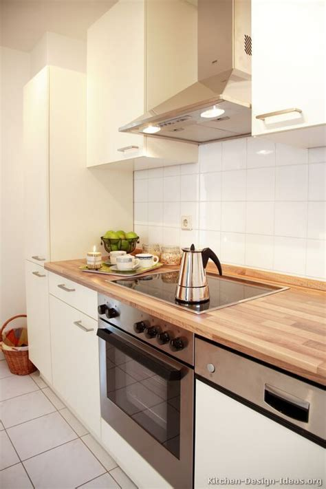 White Kitchen Cabinets With Wood Countertops Small Kitchen Idea Of The Day White Cabinets And Tile With Light Wood Grain Laminate