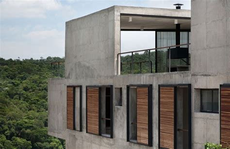 home design exterior walls hillside house with 2 concrete volumes 2nd story entrance