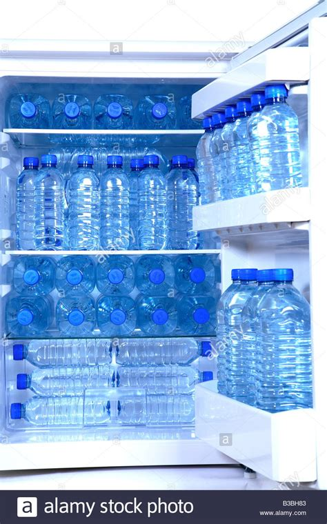 Shelf Water by Bottled Water Packed On Fridge Shelves Stock Photo