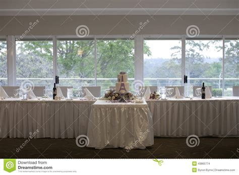table setup for wedding reception bridal table and wedding cake reception set up stock photo