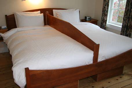 bed divider for couples bringing back the bundling board pbenjay s blog