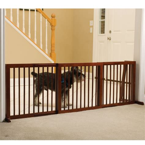 wide dog gates for the house the extra wide free standing pet gate small hammacher schlemmer