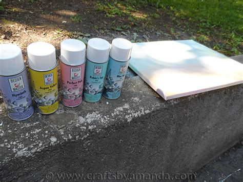 spray paint and craft button tree a beautiful canvas project of vibrant colors