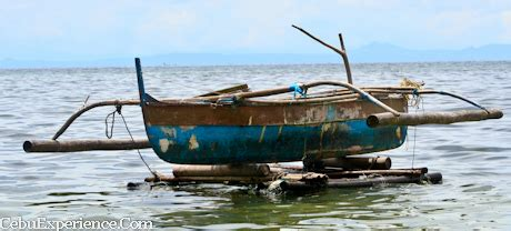 old beat up boat capturing the beauty of capitancillo islet in pictures