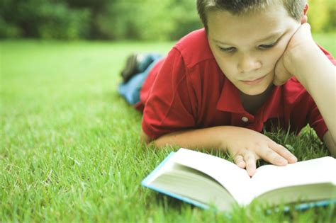picture of a child reading a book 8 tips to start building the best home library for your child
