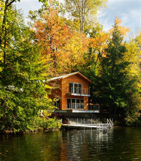 modern lake house lake house decor exterior contemporary with balcony autumn leaves