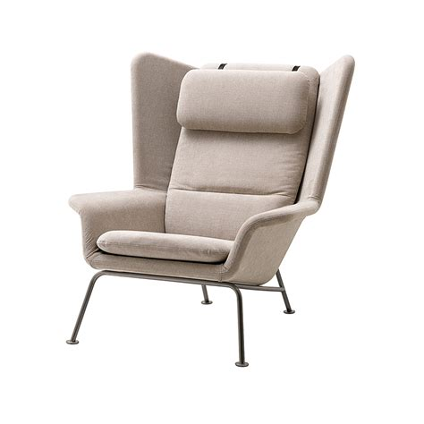 boconcept armchair comforting enveloping armchairs elle decoration uk