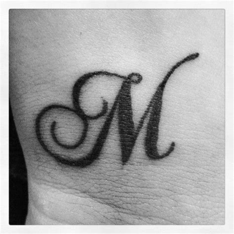 tattoo design with letter m i would love this behind my ear but have the letter quot n