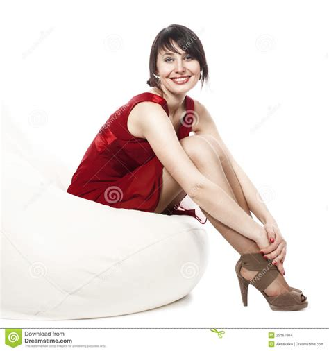 Colorful Armchair Woman In Red Dress Sitting On Armchair Stock Images