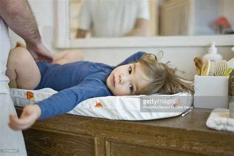 4 year old boy diaper change father changing babys diaper stock photo getty images