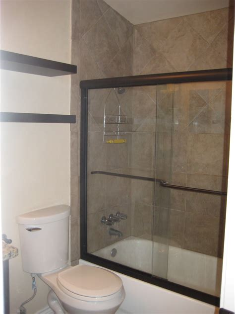 Floating Shower Shelf by Tub Shower Combo With Sliding Glass Door By Black Floating