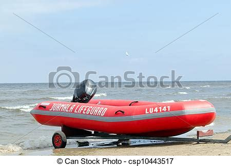 lifeguard boat clipart stock photography of rubber lifeguard boat trailer on sea