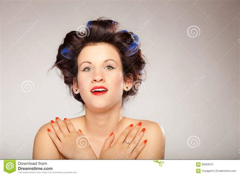 men with red fingernails and curlers in hair men with red fingernails and curlers in hair young woman