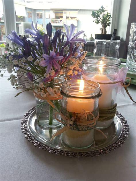 centrotavola con candele e fiori oltre 25 fantastiche idee su centrotavola con barattolo su