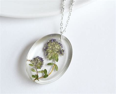 how to make pressed flower resin jewelry pressed flower jewelry in resin jewelry