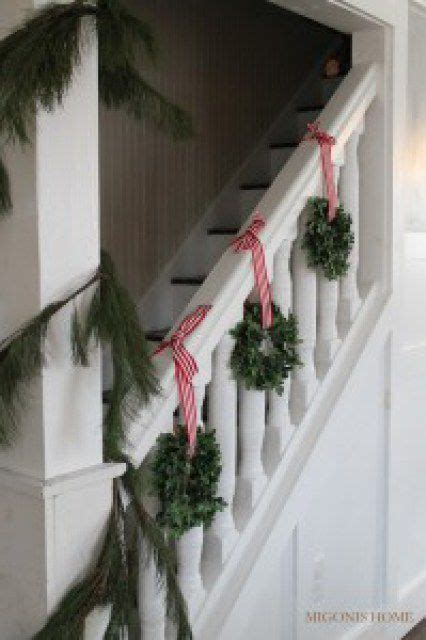 garland hangers for banister how to decorate a staircase railing for christmas