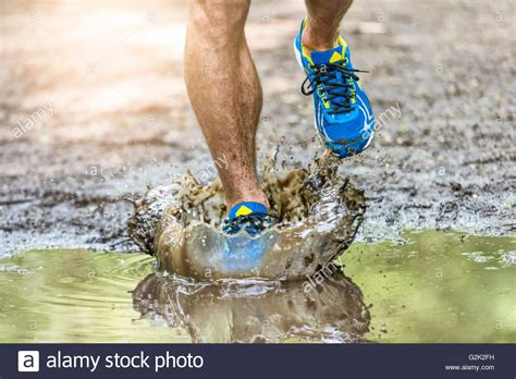mud trail running shoes running walking in a puddle splashing his shoes