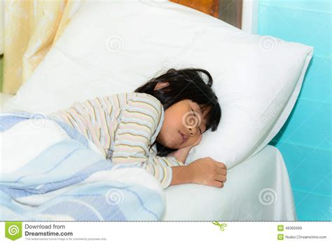 sleeping in asia adorable little girl sleeping in a bed stock image image