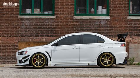 white mitsubishi lancer with black rims white paint gold rims and black face yes this is