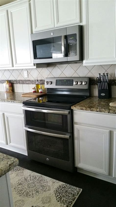black and white appliance reno ge slate appliances with antique white cabinets our