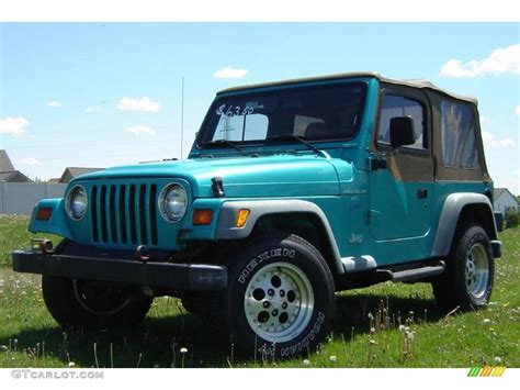 white and teal jeep 1997 bright jade satin glow jeep wrangler sport 4x4