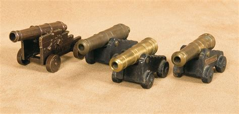 miniature cannons four antique miniature brass cannons