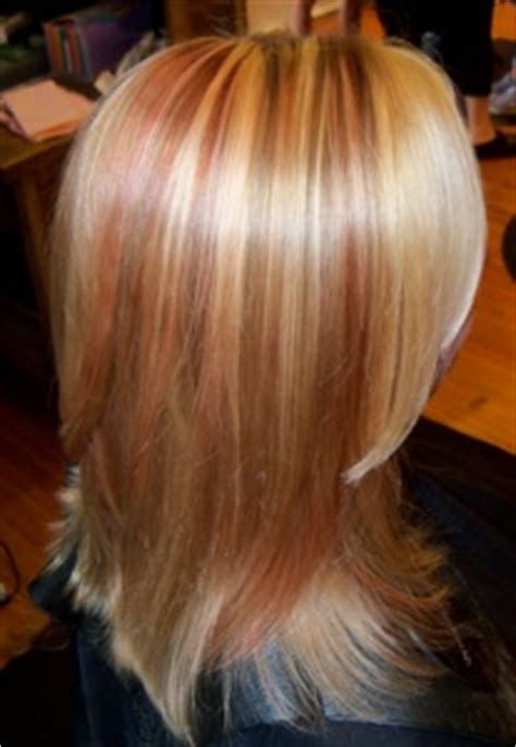 blonde highlights with copper lowlights photos of real hair behind my chair with a brief