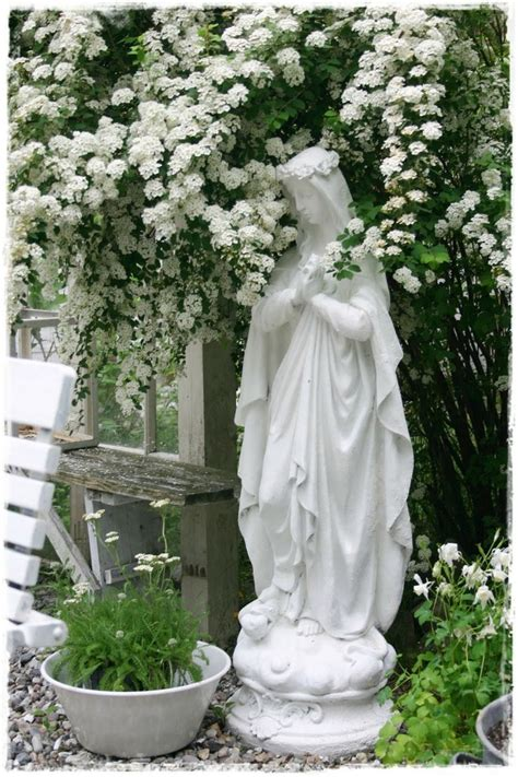 beautiful blessed mother garden statue surrounded