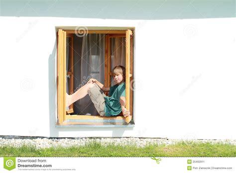 sitting window boy sitting on the window stock image image of brown 25492911