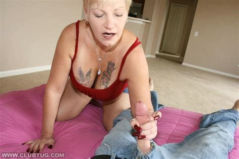 blonde mature lady with big tits gives slippery handjob
