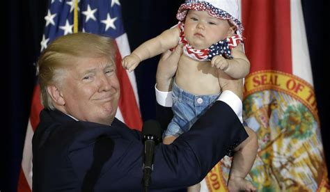 donald trump holding little boy republican presidential candidate donald trump holds up 6