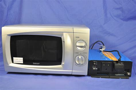 Microwave 500 Watt 24 volt inverter and silver 500 watt microwave oven