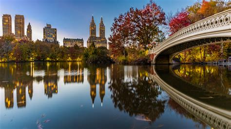 bow bridge crossing   lake central park  york