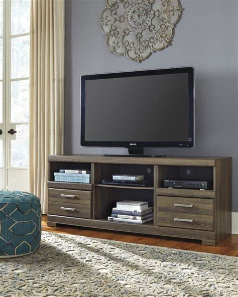 tv stand in middle of room entertainment center tv stands model home furnishings