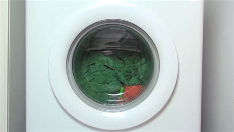 washing colored clothes in water washing machine stock footage 8030050