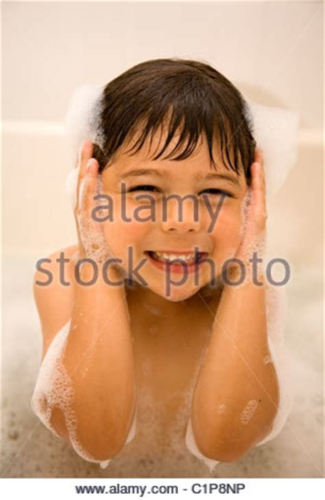 Years Bathtub by Four Year Boy With Shells Which He Has