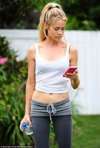 denise richards body denise richards flaunts her toned abs in cropped vest top
